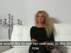 Curly haired Lillyan offers titillating cock riding delights