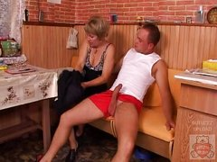 Mature mother and the Son&,#039,s friend have a good time on kitchen.